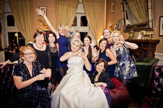 Bride and Guests Celebrate in the Patti Bar at Craig y Nos - photo by Jake Morley Wedding Photography
