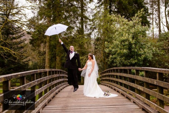 Wedding Reception Swansea, Craig y Nos Country Park Bride and Groom on Bridge by Jenkins Photography
