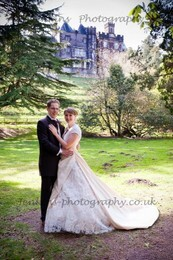 Bridal Couple in lower gardens with backdrop of Craig y Nos Castle