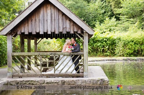 Wedding Couple by the boating lake in Craig y Nos Country Park