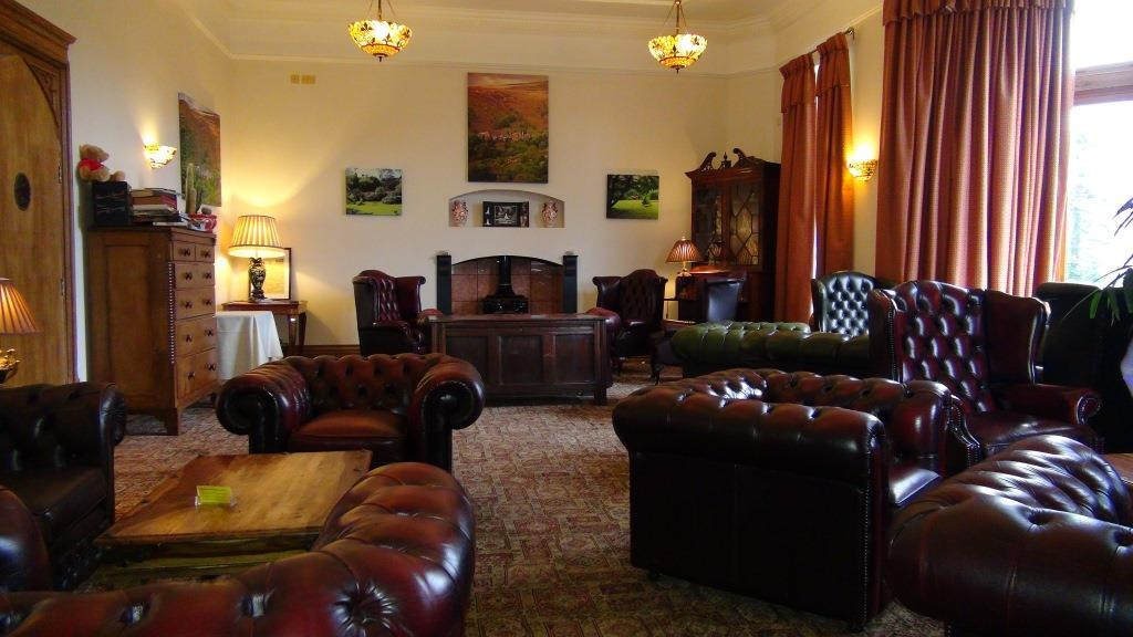 Leather chesterfield sofas and chairs in Craig y Nos Castle's Nicolini Lounge South Wales