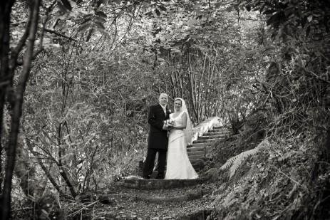 Wedding Photography by Nigel Pullen Photography, Couple on woodland path steps to lower gardens at Craig y Nos Castle