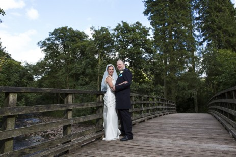 Wedding Photography by Nigel Pullen Photography, Couple on bridge in Craig y Nos Coutry Park