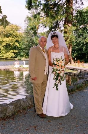 Bride and Groom by lake South Wales Wedding Venue Craig y Nos Castle