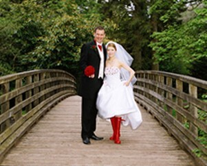 Bridal couple on bridge in Craig y Nos Country Park by Patrick Ellis Wedding Photography