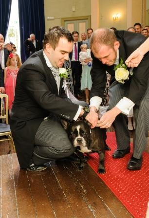 Wedding Ceremony at Craig y Nos Wedding Castle with their Dog carrying the Rings