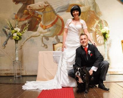 Dog Friendly Wedding Venues - Wedding Ceremony bridal couple with their dog on stage at Craig y Nos Castle - South Wales