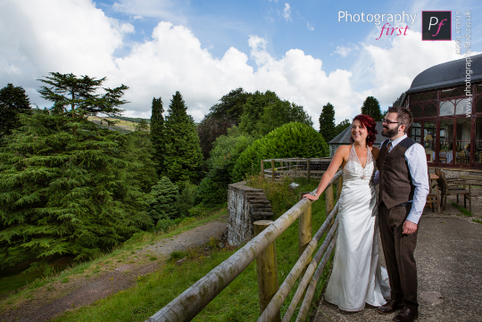 Couple outside the Conservatory at Craig y Nos Castle by Photography First