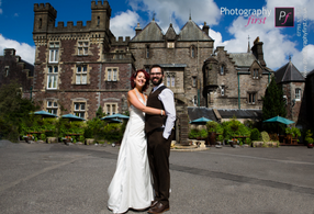 Couple in front of Craig Y Nos Wedding Castle by Photography First Wedding Photographers