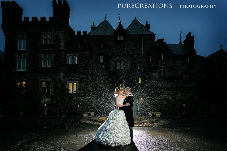 Bride and Groom in front of Craig y Nos Castle at night by Pure Creations Photography
