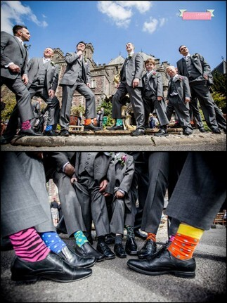 Guests show off coloured socks at Craig y Nos Castle Wedding Venue