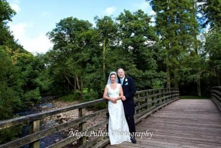 Wedding Couple on Bridge in Craig y Nos Country Park by Nigel Pullen Wedding Photography